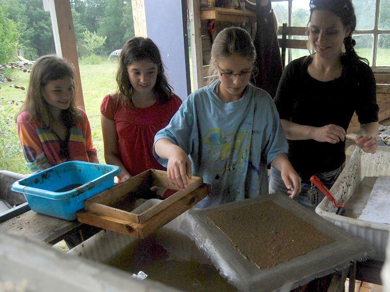 Girls making paper